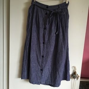 Blue cotton skirt with tie, buttons, and pockets